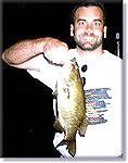 nice smallmouth at sunset on flyrod popper Upper Saranac Lake, NYSmallmouth topwater at nightphoto property of Guides For Hire.com